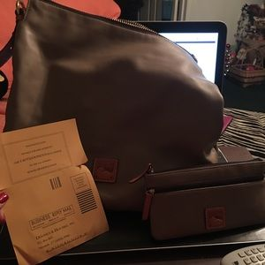 Dooney and Bourke handbag with matching wallet.